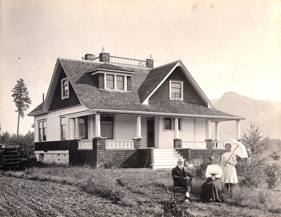 Alexander Leslie Fortune and his wife Bathia with a younger lady standing in front of their home